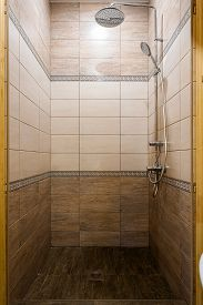 Bathroom In A Traditional Style With Brown And Beige Walls.minimalist Shower Room With Hotel Sauna