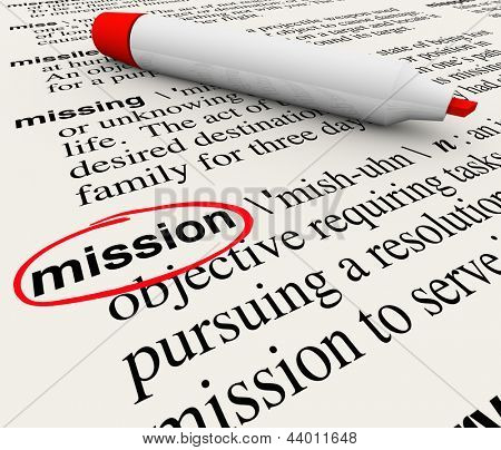 A dictionary page with the definition for the word Mission circled with a red marker to define a task, job, objective, or plan you want to achieve or accomplish