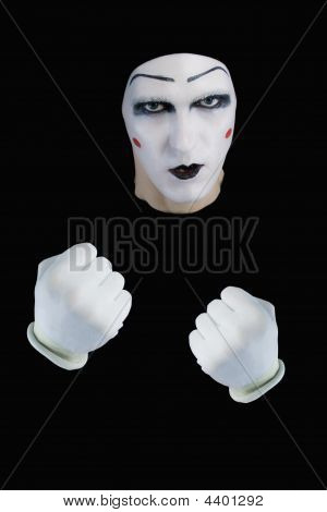 mime with the compressed fists on a black background poster