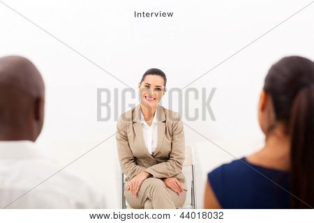 caucasian woman during employment interview with two human resources personnel