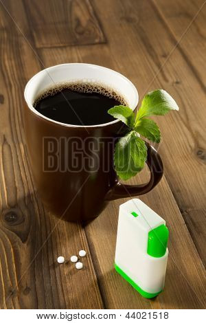 Mug of coffee with stevia tablets as natural and healthy sweetener