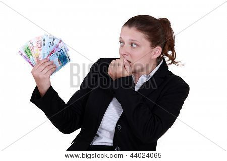 female entrepreneur holding bunch of bank notes