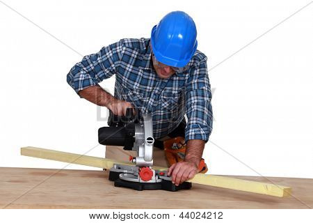 Woodworker using miter saw
