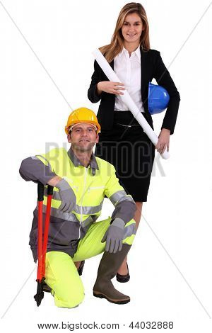 Professional woman standing next to a blue collar worker