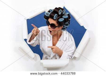 Brunette wearing hair-rollers and sunglasses