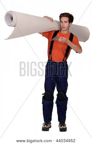 Man carrying roll of carpet