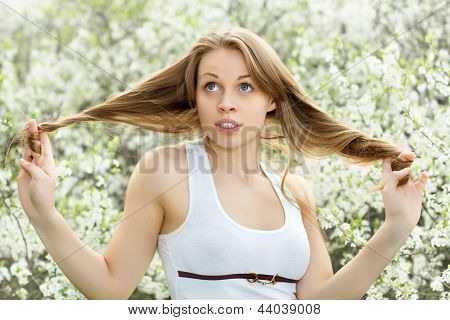 Blonde Playing With Her Hair