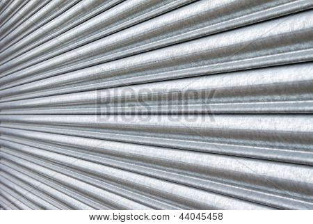 Silver Metal Roller Security Shutters Closed Down