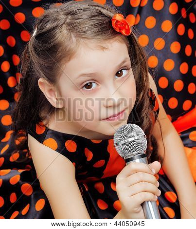 Closeup little girl with microphone