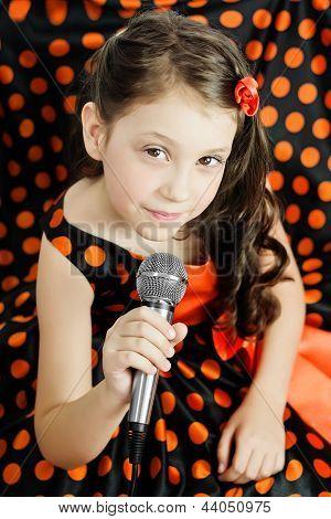 Little girl in orange peas dress
