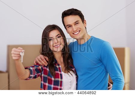 Young couple holding keys in hand