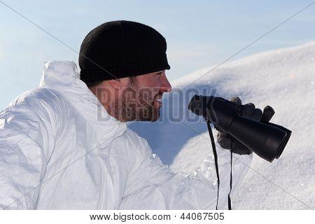 Commandos  In White Camouflage Looking Through Binoculars. Portrait In Profile