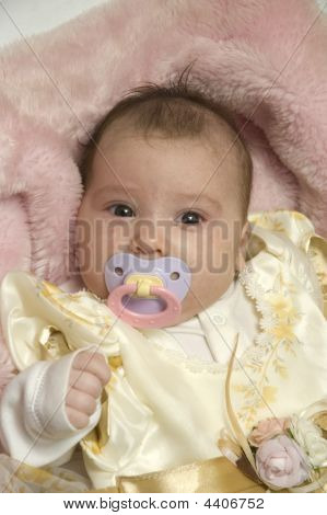 one month old Baby with dummy in mouth poster