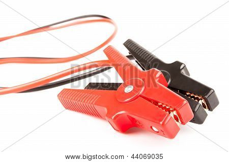 Car battery jumper cables over a white background