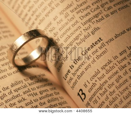 Ring With Love Heart Shadow On Bible