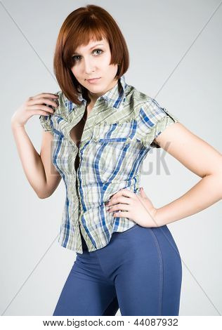Attractive young brunette in a plaid shirt