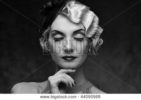 Monochrome portrait of elegant blond retro woman   with beautiful hairdo and little hat