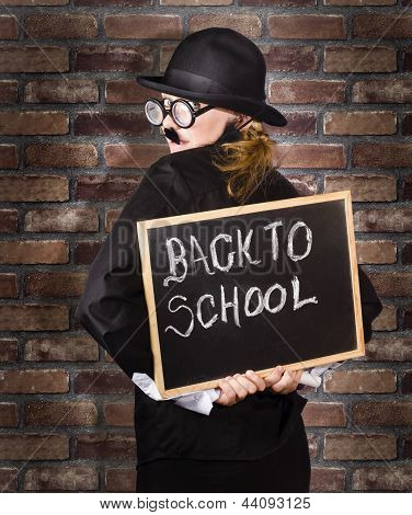Back To School Teacher Holding Blackboard And Chalk