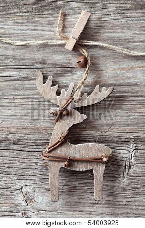 Wooden christmas deer on wooden background