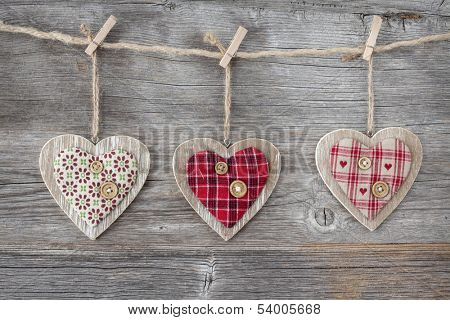 Hearts over a wooden background