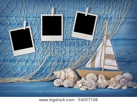 Marine life decoration and instant photos on blue shabby background poster