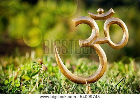 Om Statue On The Grass