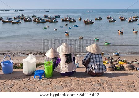 Three Women In Conical Hats In Fishing Village. Mui Ne. Vietnam