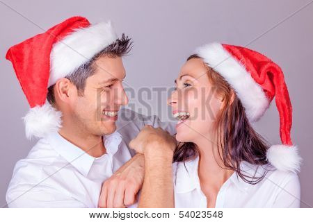 happy laughing couple isolated with red hats