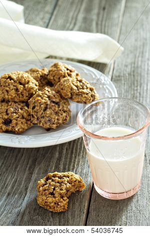 Pumpkin oat cookies on a plate with milk