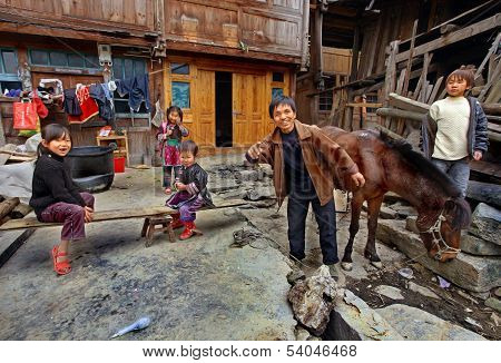 Asian Family Peasant Farmers In Rural Areas Of Southwestern China.