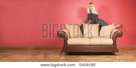 Young Woman On A Sofa