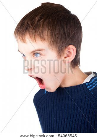 Angry boy wearing blue sweater shouting on white background