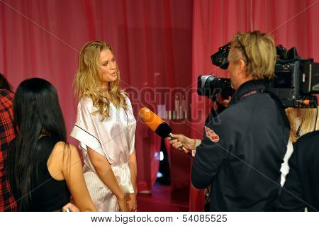 NEW YORK NY - NOVEMBER 13: Model Toni Garrn giving away interviews backstage