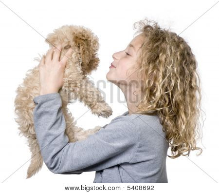 Young girl with her toy Poodle puppy (9 weeks old) in front of a white background poster