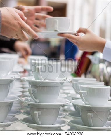 Taking A Coffee From A Buffet
