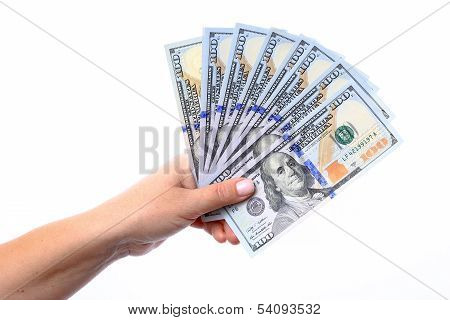 Hand Holding A New Hundred Dollar Bills U.s. Folded Like A Fan, Released Into The Circulation In Oct