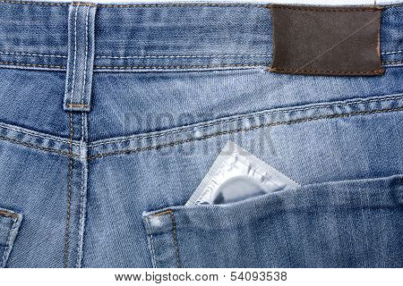 Close-up old jeans and a condom in his back pocket symbol of safe sex poster