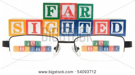 Letter Blocks Spelling Far Sighted With A Pair Of Glasses