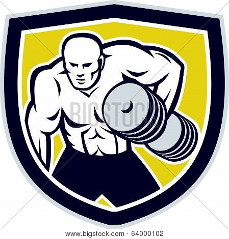 Illustration of a strongman muscular guy lifting dumbbells weight training viewed from front set inside shield crest shape done in retro style. poster