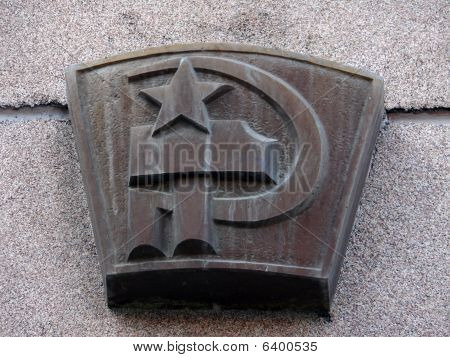 Old gray sign Of A Communism - sickle and hammer