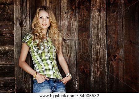 Portrait of Young Hipster Woman at the Wooden Wall