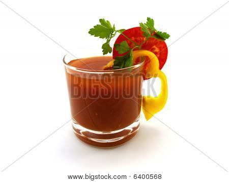 Tomato Juice With A Segment Of A Tomato Of Pepper And Parsley