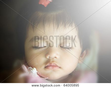 Close-up Portrait Of Beautiful Sleeping Baby