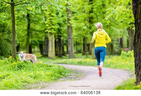 Woman Running In Summer Park