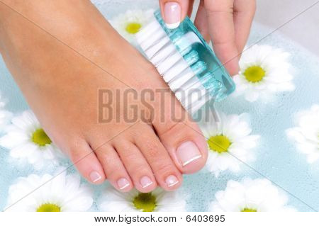 Female Washes And Cleans The Toenails