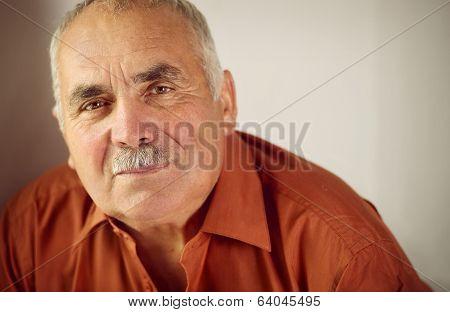 Friendly Senior Man With A Moustache
