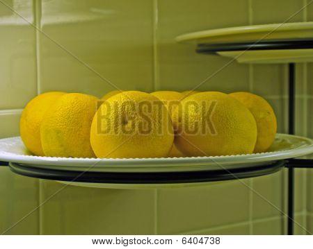 Oranges on Plate