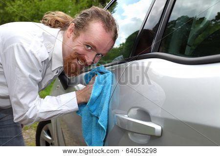 Portrait Of Funny Man Washing Car With A Cloth
