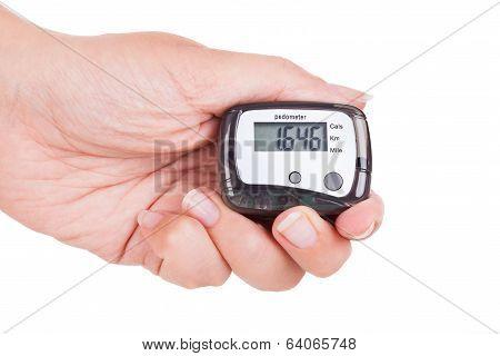 Hand Holding Digital Pedometer