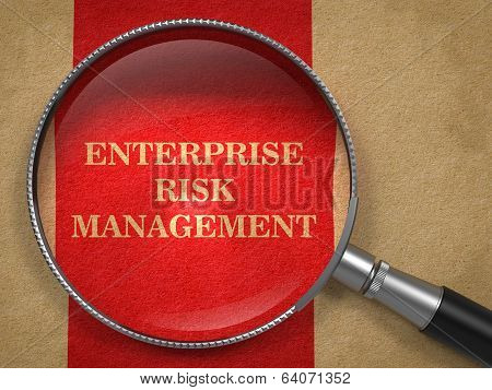 Enterprise Risk Management. Magnifying Glass on Old Paper.